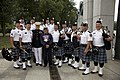 The 35th Commandant of the Marine Corps, Gen. James F. Amos, front row third from left, poses for a photo with a World War II veteran and members of the Providence Police Department Pipes and Drums during 130928-M-LU710-034.jpg