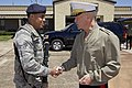 The 35th Commandant of the Marine Corps, Gen. James F. Amos, right, shakes hands with an Air Force Senior Airman after visiting the Marine Fighter Attack Training Squadron 501 (VMFAT-501) at Eglin Air Force 130504-M-LU710-230.jpg