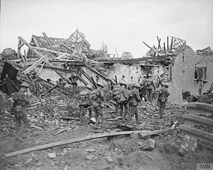 19th Battalion, London Regiment (St Pancras) - A patrol of 1/19th Londons moves through a shattered village near Ypres, 27 August 1917