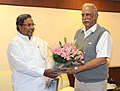 The Chief Minister of Karnataka, Shri Siddaramaiah meeting the Union Minister for Civil Aviation, Shri Ashok Gajapathi Raju Pusapati, in New Delhi on November 07, 2014.jpg