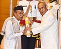The President, Shri Pranab Mukherjee presenting the Padma Shri Award to Pandit Tulsidas Borkar, at a Civil Investiture Ceremony, at Rashtrapati Bhavan, in New Delhi on March 28, 2016.jpg