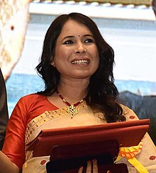 The President, Shri Ram Nath Kovind presenting the Swarna Kamal Award to the director Rima Das, for best Assamese feature film – VILLAGE ROCKSTARS, at the 65th National Film Awards Function, in New Delhi (cropped).JPG