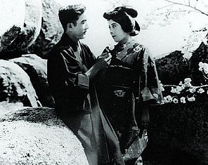 Tsuru Aoki - Tsuru Aoki (right) with actor and husband Sessue Hayakawa in a screen shot of the 1919 film The Dragon Painter.
