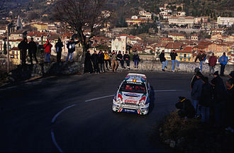 Toyota in motorsport - Double world champion Carlos Sainz driving a Toyota Corolla WRC at the 1999 Monte Carlo Rally.
