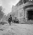 Troops and scout car in Arnhem 1945.jpg