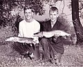 Two Young Men Holding Fish (15097156756).jpg