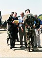 Two days after the attack, Secretary of the Army Thomas E. White (in white shirt) and Major General James T. Jackson, USA, Commanding General, U.S. Army Military District of Washington, are briefed by FBI 010913-A-CA715-004.jpg