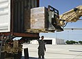 U.S. Army Spc. Ian Gleason, with Headquarters Company, 1st Battalion, 279th Infantry Regiment, 45th Infantry Brigade Combat Team, Oklahoma Army National Guard, guides a forklift driver loading meals, ready to 130523-Z-TK779-063.jpg