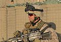 U.S. Marine Corps Lance Cpl. Matt O. Muldoon, an M249 light machine gunner with Golf Company, 2nd Battalion, 2nd Marine Regiment, takes a knee during a patrol through the fields and town of Loy Darwayshan in 091204-M-EK802-001.jpg