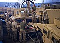 U.S. Marines with the 24th Marine Expeditionary Unit (MEU) clean weapons and prepare vehicles aboard a landing craft, air cushion in the well deck of the amphibious transport dock ship USS New York (LPD 21) 120412-N-XK513-055.jpg