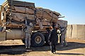 U.S. Soldiers assigned to Bravo Company, 2nd Battalion, 8th Cavalry Regiment, 1st Brigade, 1st Cavalry Division prepare to unload HESCO barriers to distribute to Iraqi police in Diwaniyah, Iraq, Oct 111030-A-PQ424-094.jpg