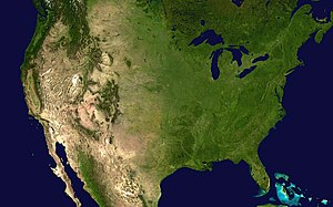 Geography of the United States - A satellite composite image of the contiguous United States. Deciduous vegetation and grasslands prevail in the east, transitioning to prairies, boreal forests, and the Rockies in the west, and deserts in the southwest. In the northeast, the coasts of the Great Lakes and Atlantic seaboard host much of the country's population.