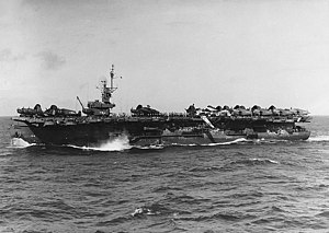 USS Attu after weathering a typhoon. Several aircraft are in disarray on deck.