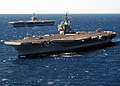 USS John F. Kennedy (CV-67) with USS Theodore Roosevelt (CVN-71).jpg