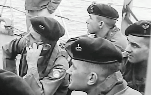 Green beret - U.S. Army Special Forces soldiers receiving instruction aboard a U.S. Naval ship off the coast of White Beach, Okinawa, Japan in 1956, wearing their green berets prior to their approved wear in 1961.