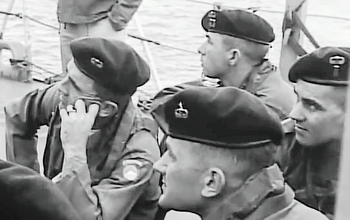 c1fc21d667ad US Army Special Forces soldiers wearing green berets and using their  Parachutist Badge as the beret's flash, circa 1956