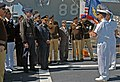 US Navy (USN) Captain (CAPT) Charles M. Gaouette (foreground right), Commanding Officer (CO) of the USN Ticonderoga Class Guided Missile Cruiser, USS BUNKER HILL (CG 52), talks with - DPLA - f2ba1b44f5422444cb275f52f67a4eeb.jpeg
