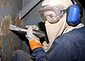 US Navy 030121-N-6651N-003 using a needle gun to removes layers of paint.jpg