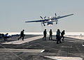 US Navy 031018-N-8295E-112 A C-2A Greyhound assigned to the Rawhides of Carrier Logistics Support Squadron Forty (VRC-40), takes off from the flight deck aboard USS Ronald Reagan (CVN 76).jpg