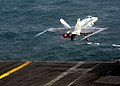US Navy 040107-N-7278A-001 An F-A 18 Hornet assigned to the Checkerboards of Marine Strike Fighter Squadron Three One Two (VMFA-312) launches from one of four steam driven catapults on the flight deck aboard USS Enterprise (CVN.jpg