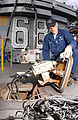 US Navy 040518-N-2143T-001 Airman Steve Lefevre from Saginaw, Mich., scrubs corrosion off a control box while conducting a Planned Maintenance Subsystem (PMS) action aboard USS Nimitz (CVN 68).jpg