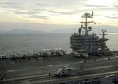 US Navy 050103-N-9951E-001 The Nimitz-class aircraft carrier USS Abraham Lincoln steams off the coast of Aceh, Sumatra, Indonesia while personnel on the flight deck prepare to launch Seahawk helicopters.jpg