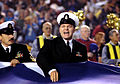US Navy 050109-N-1722M-005 Chief Yeoman Larry Smith, assigned to USS Ronald Reagan (CVN 76), shouts out commands during the wave of a reproduction Continental U.S. shaped flag during the National Anthem prior to the San Diego C.jpg