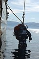 US Navy 050623-N-1464F-046 U.S. Navy civilian contractor Nate Kibbler is lowered into the water in the Atmospheric Diving System (ADS 2000).jpg