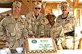 US Navy 060305-N-3750S-030 Capt. Eric Odderstol, UCCM Craig Nelson, CSSN Kevin Beckworth and Rear Adm. Albert Garcia III, celebrate the Seabees' 64th birthday.jpg