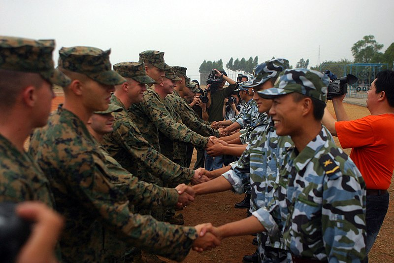 """File:US Navy 061117-M-9827H-045 Marines and People's Liberation Army (Navy) (PLA(N)) 1st Marine Brigade Marines shake hands at the start of """"Marine Day"""" 1st Marine Brigade's obstacle course.jpg"""