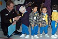 US Navy 070205-N-9604C-308 Lt. Walt Cline, bandmaster of the 7th Fleet Navy Band, talks to a group of students at the Society for Protection of Children, Hok Sam House nursery school.jpg