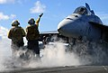 US Navy 070808-N-0890S-030 Aviation Boatswain's Mate (Handling) 3rd Class Anthony Coark directs an F-A-18E Super Hornet, assigned to the.jpg