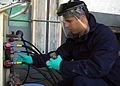 US Navy 080108-N-0577G-001 Aviation Support Equipment Technician 2nd Class Federico Munoz, from New York, prepares to take a hydraulic sample from a T-6 hydraulic dispensing unit.jpg