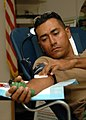 US Navy 081122-N-8816D-113 Engineering Aide Constructionman Roberto Diaz, assigned to Naval Mobile Construction Battalion (NMCB) 133, applies pressure to a gauze on his arm after donating blood during a blood drive hosted by NM.jpg