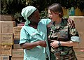 US Navy 090207-N-1655H-348 A Vivre Ensemble orphanage staff member thanks Capt. Cynthia Thebaud, commander of Africa Partnership Station, after a team of Africa Partnership Station members delivered donated medical and child ca.jpg