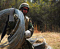US Navy 090305-N-7268B-007 Builder 2nd Class Matthew Rowley, assigned to Naval Mobile Construction Battalion (NMCB) 1, uses concertina wire to set up a defensive perimeter.jpg