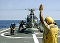 US Navy 090426-N-7092S-451 1-Er. Miestre Jesus Espinosa Santiago guides a Bolkow BO-105 helicopter to land on the flight deck of the Mexican Navy ocean patrol ship ARM Oaxaca (PO-161).jpg