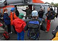US Navy 090505-N-9860Y-002 Naval Aircrewman 1st Class Chad Lewis, from Naval Air Station Whidbey Island Search and Rescue, briefs Bellingham Mountain Rescue Council volunteers on hoist operations.jpg