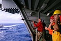 US Navy 100202-N-8878B-062 Chief Warrant Officer Timothy Lindley, from Waco, TX, shoots a shot line to the guided-missile cruiser USS Bunker Hill (CG 52) from the Nimitz-Class aircraft carrier USS Carl Vinson (CVN 70).jpg