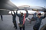 US Navy 101207-N-6770T-233 Sailors assigned to Naval Strike and Air Warfare Center unload ordnance from an F-A-18E after a daytime training mission.jpg