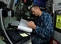 US Navy 110202-N-7705S-009 Hospital Corpsman 1st Class Kevin Caldwell reviews a health record in the medical office aboard the Los Angeles-class at.jpg