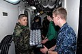 US Navy 110314-N-KF029-060 Sailors aboard the aircraft carrier USS Ronald Reagan (CVN 76) move cases of drinking water aboard the aircraft carrier.jpg