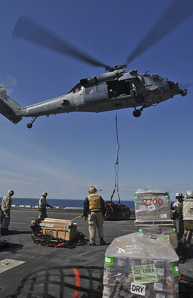 File:US Navy 110403-N-9950J-150 An MH-60S Sea Hawk helicopter drops off supplies aboard USS Essex (LHD 2) during a vertical replenishment.jpg
