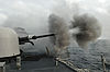 US Navy 110606-N-NL541-341 The MK-75 76mm mounted gun aboard USS Thach (FFG 43) is fired during a live-fire exercise off the coast of Chile.jpg