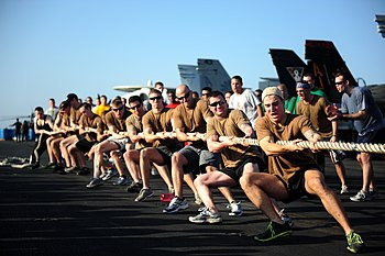 US Navy 111116-N-QL471-831 Sailors from Helicopter Sea Combat Squadron 9 compete in a tug of war challenge during a Captain's Cup competition on th.jpg