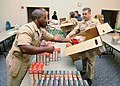 US Navy 111121-N-WJ386-003 Sailors assigned to Naval Support Activity Mid-South pack boxes of Thanksgiving items for local-area Sailors and their f.jpg