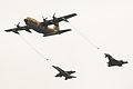 Un KC-130H Hercules del Ejército del Aire simula un repostaje en vuelo a un EF-18 y a un Eurofighter (14918529183).jpg