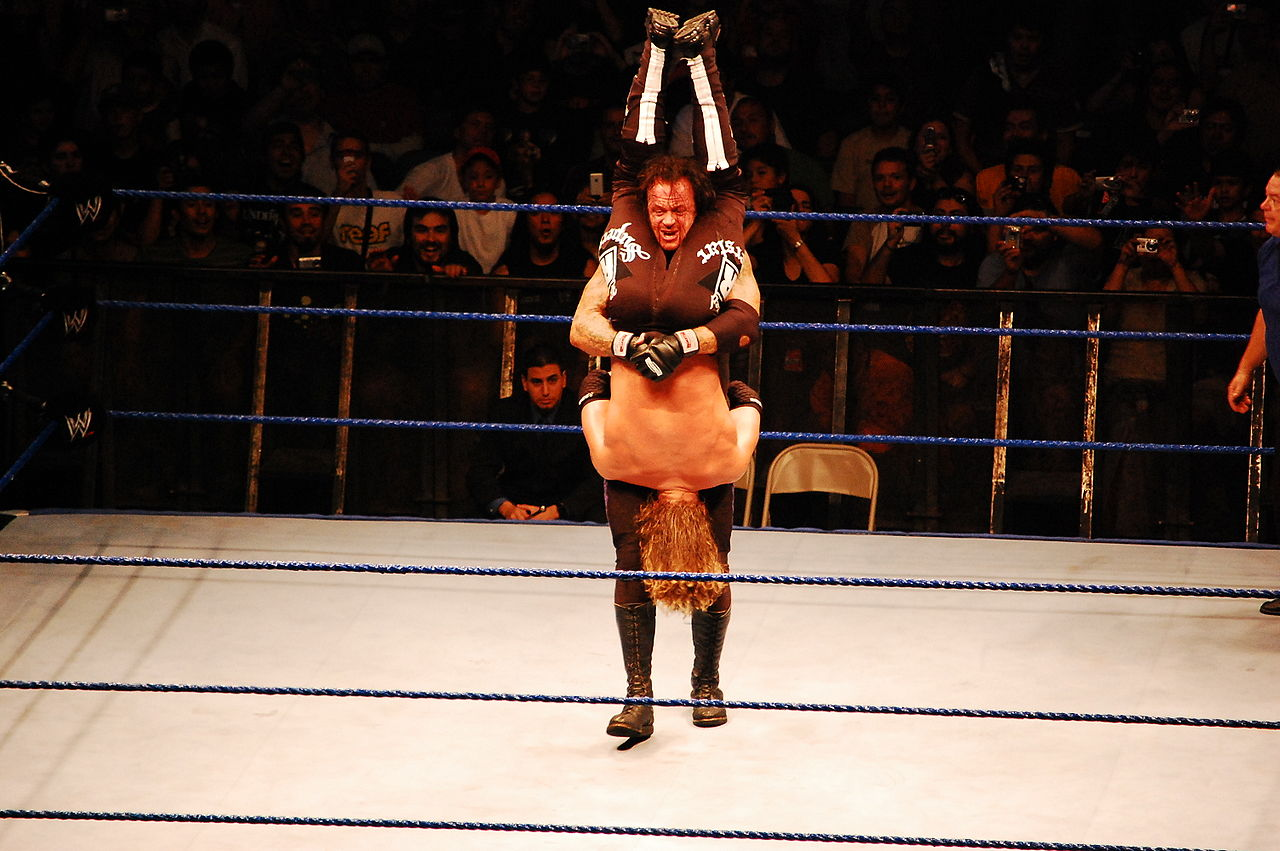 File:Undertaker Piledriver in Edge.jpg - Wikimedia Commons  File:Undertaker...