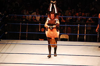 La Familia (professional wrestling) - The Undertaker, here giving Edge a Tombstone Piledriver, sent Edge to Hell.