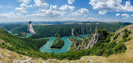 Uvac Gorge, one of the last habitats of the griffon vulture in Europe Uvac River and Eagle.jpg